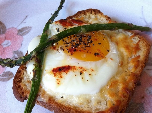 egg with yolk oozing from the center and melted mozzarella on toast ...